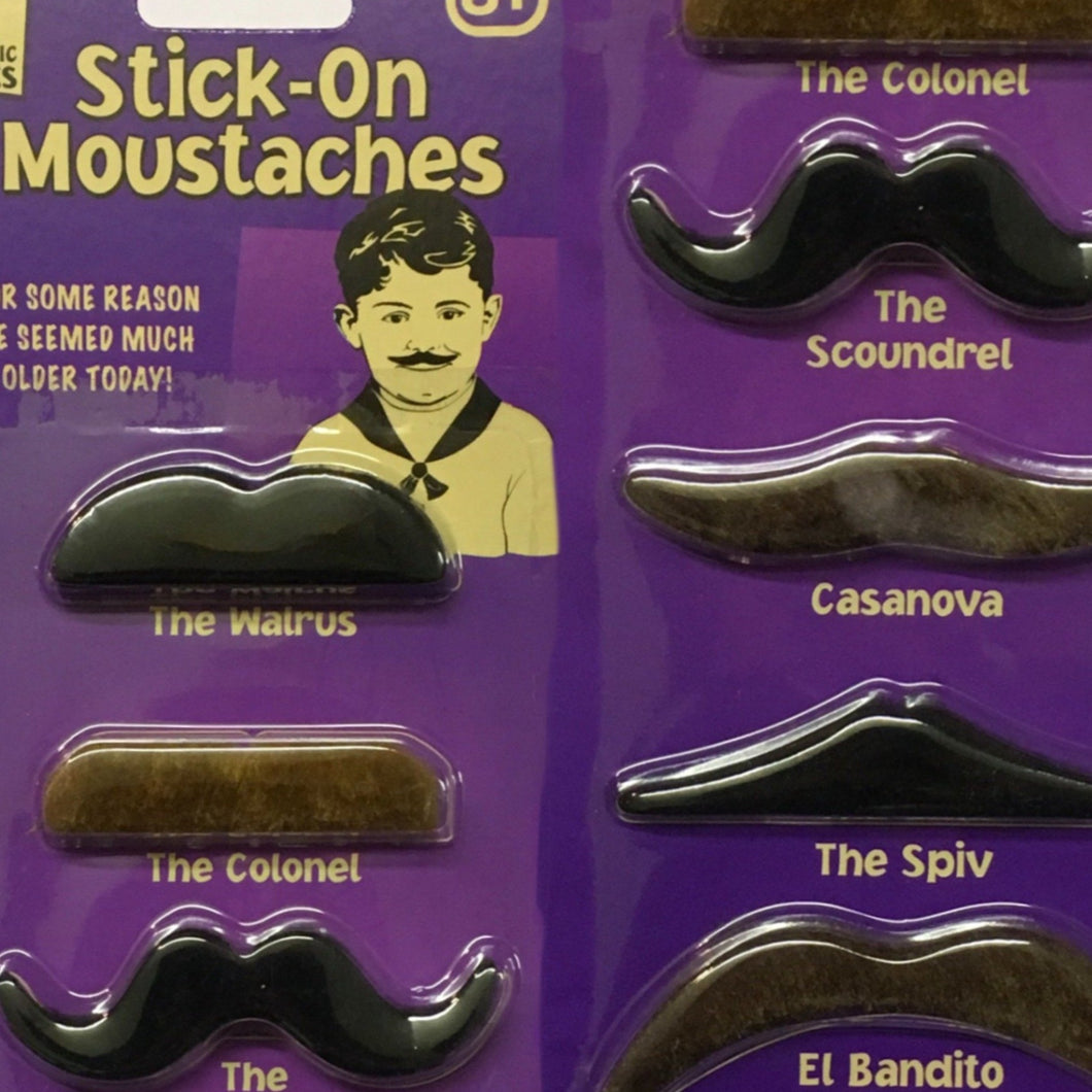 A selection of 8 black and brown stick on moustaches in different styles.