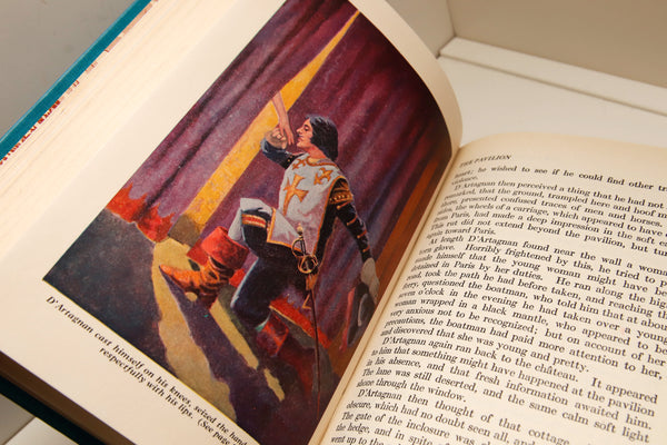 "Children's Bookshelf ""The Three Musketeers"" [c. 1931]  cloth wrapped hardcover Illustrated by Edward Robbins Higgins"