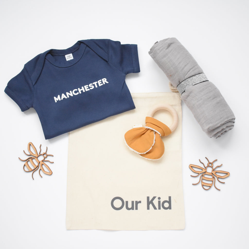 OUR KID BUNDLE - Manchester Slogan Vest in Navy with Large Grey Muslin and Fabelab Teether