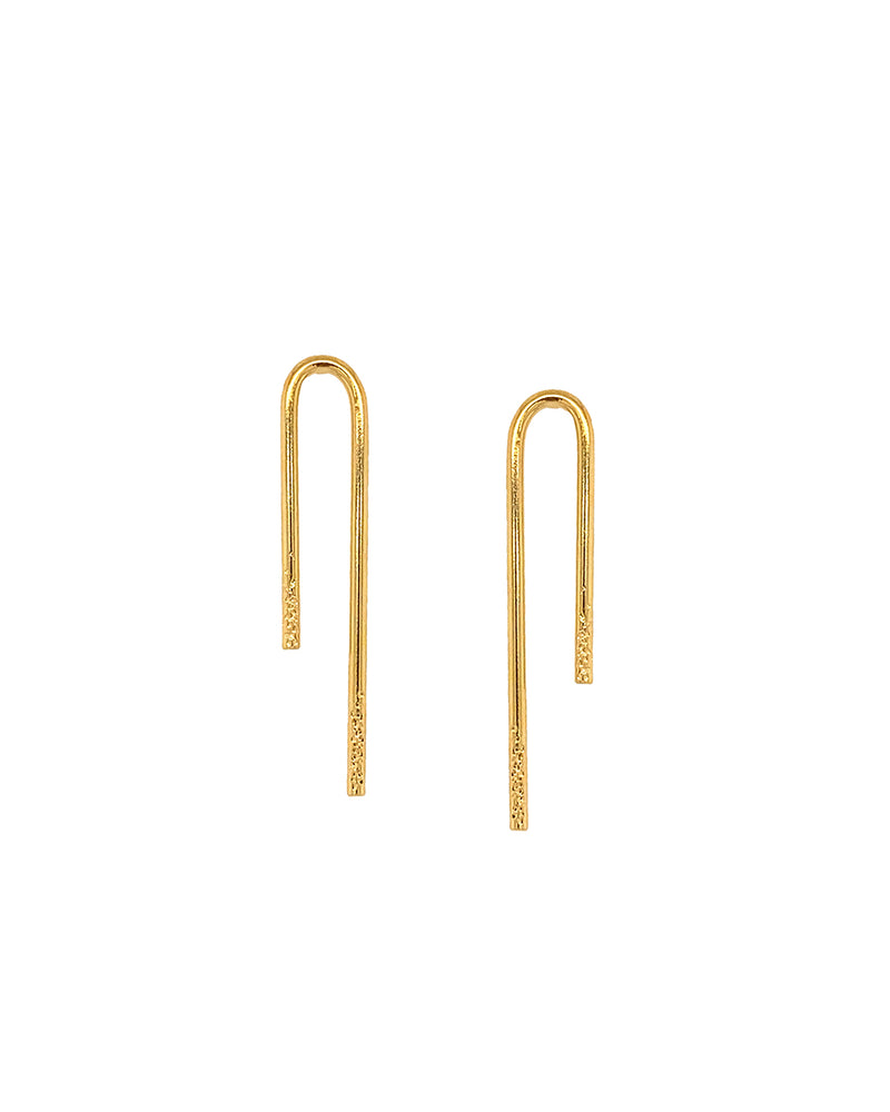 a pair of asymmetrical upside down paper clip design stud earrings with texture along the bottom ends