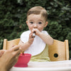 Young toddler eating from the pink Learning Spoon Set