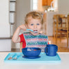A little wide eyed boy using the aqua spoon Learning Cutlery Set