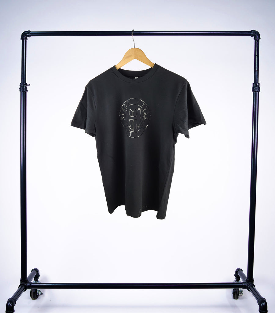 "Black Lives Matter Black on Black shortsleeved crewneck Tee by GHD. All profits go to charity ""Campaign Zero"" to stop police violence nationwide through community programs and national policy reform"