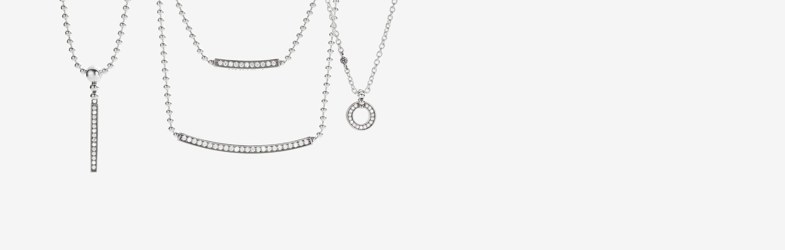 Diamond station necklaces and diamond pendant necklaces set in sterling silver.