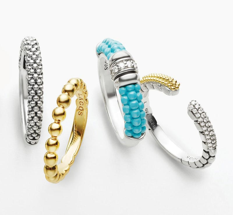 Black, light blue, dark blue, pink, and white ceramic Caviar beaded Color Switch stacking rings with our other best-sellers.