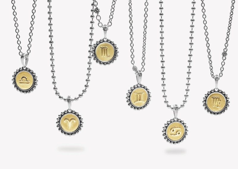 LAGOS Zodiac sterling silver and 18K gold Signature Caviar charms pendants draping on sliver chains.