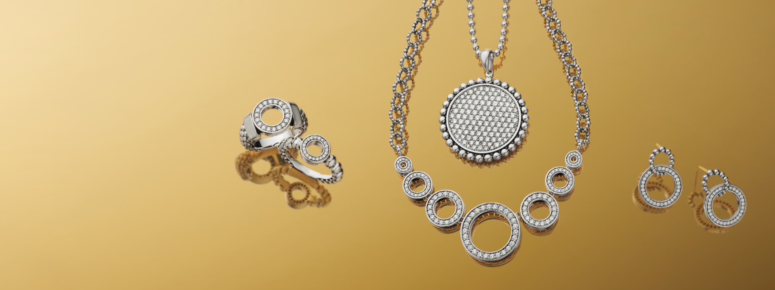 Necklaces, bracelets and rings featuring Caviar beading in fold, silver and blue or white cermaic style.