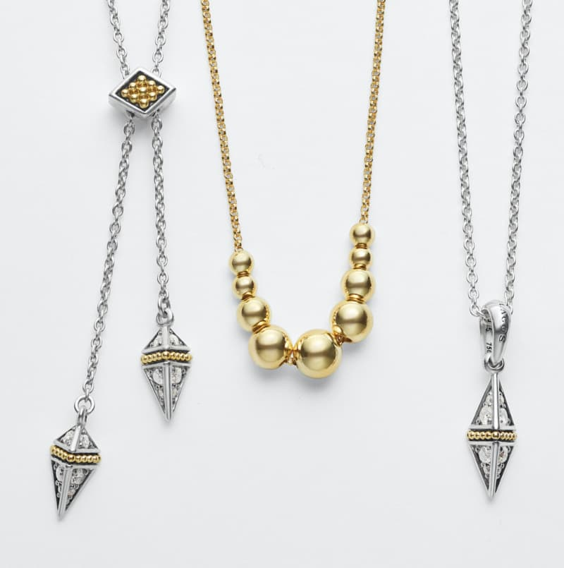 Necklaces from left to right: Nine 18K gold graduated beaded accents form charm on the first necklace, second is the Caviar Spark Diamond Circle Necklace, Maya Heart Mother of Pearl necklace is the third, the fourth has a single 18K gold pendant dotted with Caviar beading.