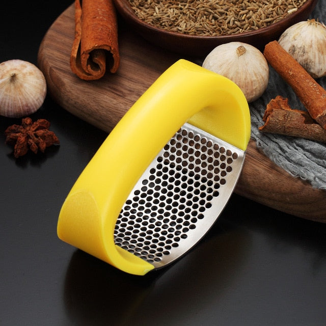 Hand-held Garlic Press
