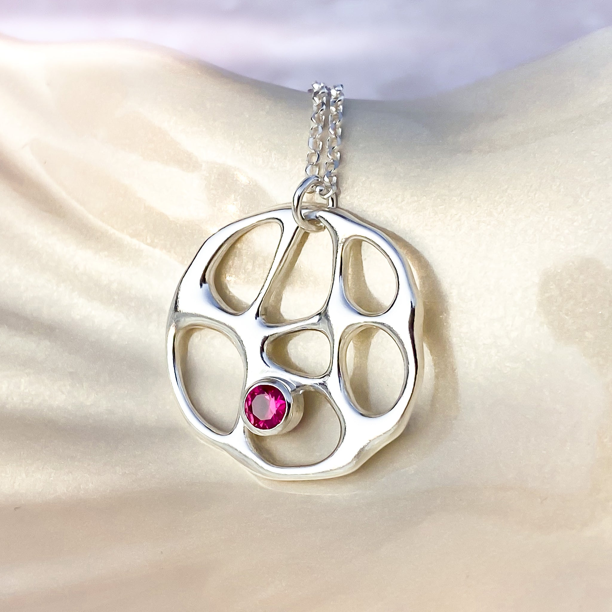 Silver Infinity Necklace with Ruby Corundum