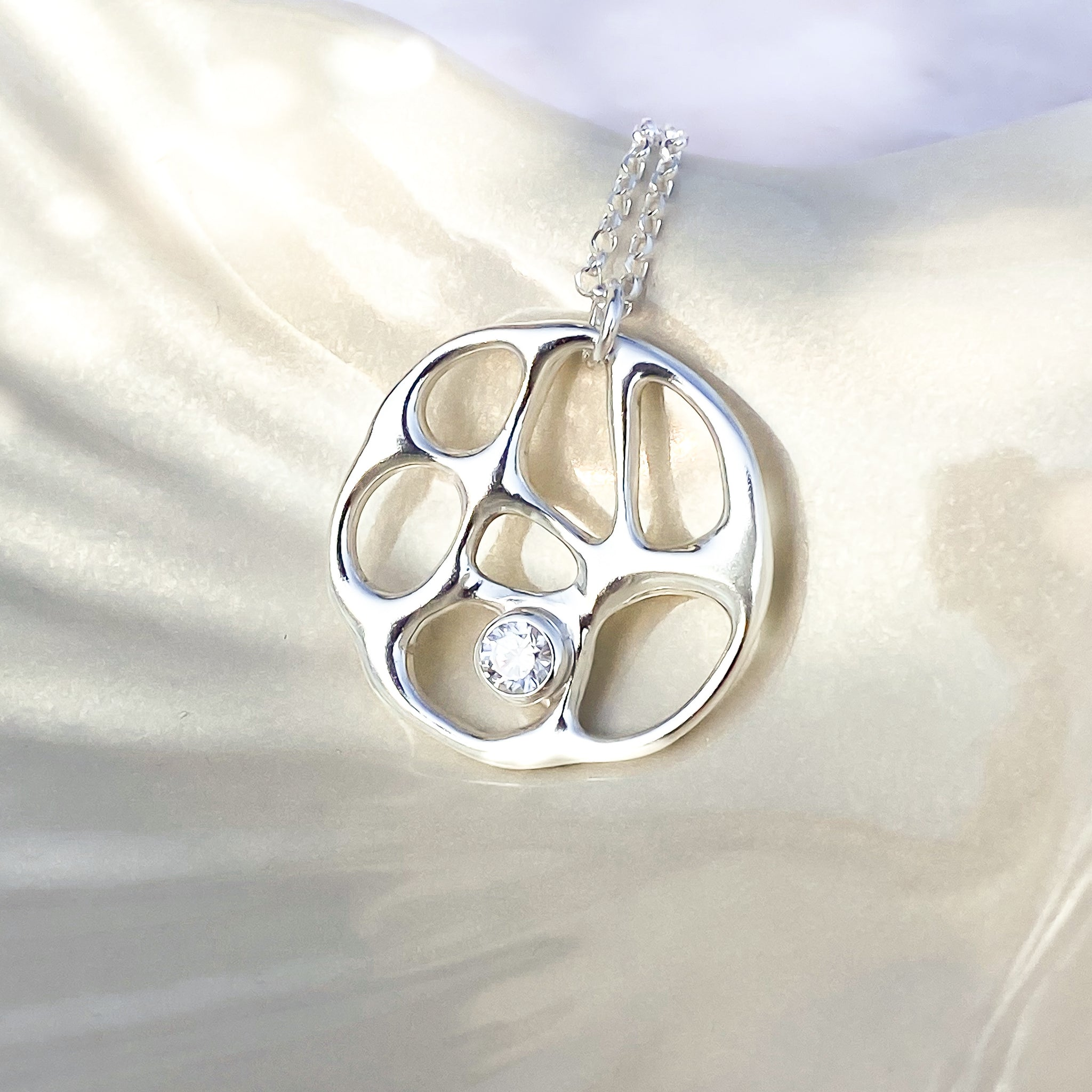 Silver Infinity Necklace with White Topaz