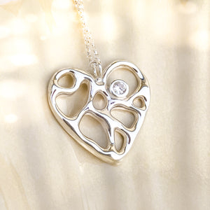 Silver Infinity Heart Necklace with White Topaz