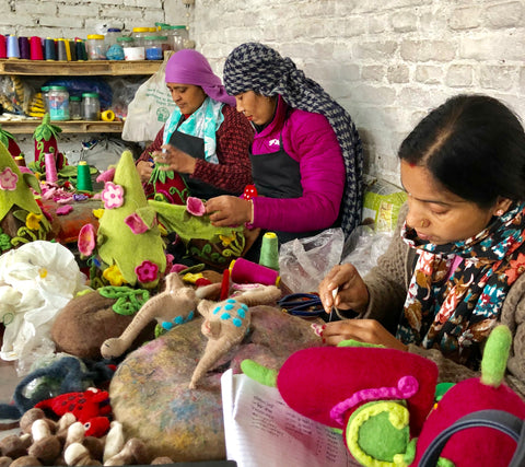 Making fair trade felt gifts and decorations inside our factory in Kathmandu, Nepal