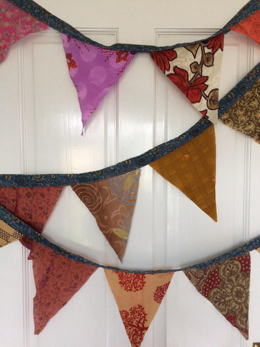 Recycled sari silk bunting, party, decoration. Buy now at Emma's Emporium, hippy ethnic fairtrade fashion, clothing, and gifts.