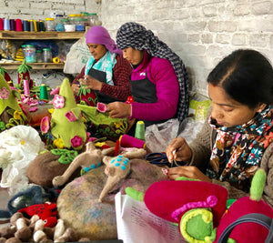 Hand made fair trade felt workshop in Kathmandu, Nepal. Felt decorations available to buy through Emma's Emporium.