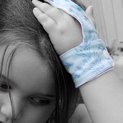 child wearing a finger guard