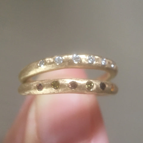 thin tapered band with six fine diamonds