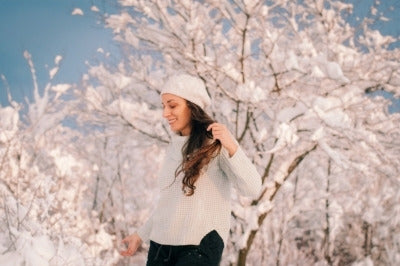 Woman going for a nature walk in snowy background.