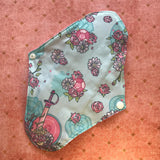 Reusable Menstrual Pad, with the decorative back facing the viewer.