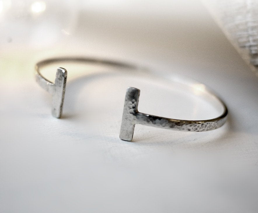 Sterling silver hammered bangle with bar ends