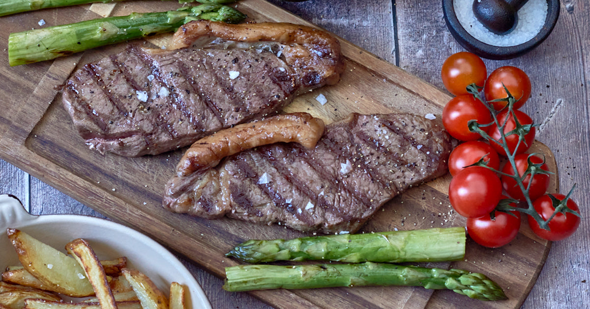 Sirloin Steaks with black garlic, asparagus and oven cooked chips