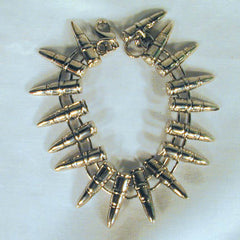 CIRCLE OF METAL BULLET SHAPED BRACELETS (Sold by the PIECE OR dozen) CLOSEOUT $ 50 CENTS EA