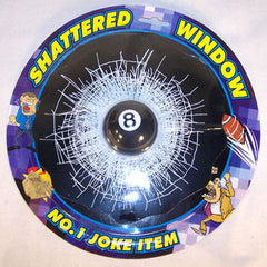 BILLIARDS EIGHT BALL IN BROKEN 7 INCH WINDOW TRICK  (Sold by the dozen) *- CLOSEOUT NOW ONLY .50 CENTS EACH