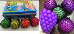 MESH SQUISH SQUEEZE POP OUT STRESS BALLS (Sold by the dozen)