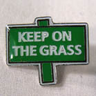 KEEP ON THE GRASS HAT / JACKET PIN (Sold by the dozen)
