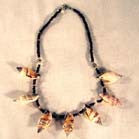 LARGE SHELLS ON COCONUT SHELL 18 IN NECLACE -(sold by the piece or dozen ) - * CLOSEOUT NOW ONLY 50 CENTS EA