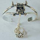 HORNED SKULL WITH CROSSBONES SLAVE BRACELET W RING ON CHIAN (Sold by the piece) *- CLOSEOUT NOW $ 5 EA
