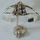 PILE OF SKULLS SLAVE BRACELET W RING ON CHIAN ( Sold by the piece)