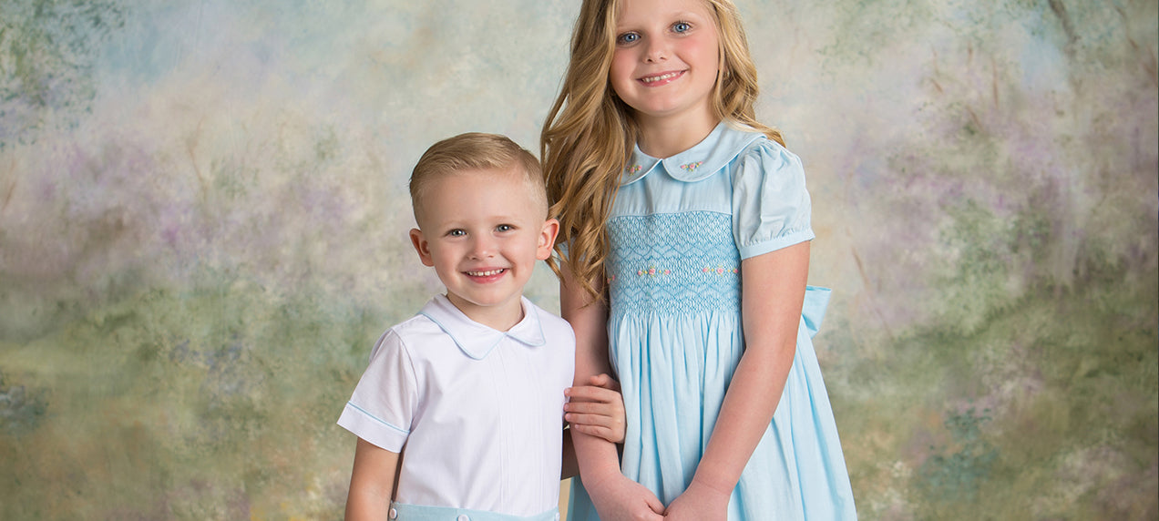 sibling smocked dresses with matching brother outfit in blue and white