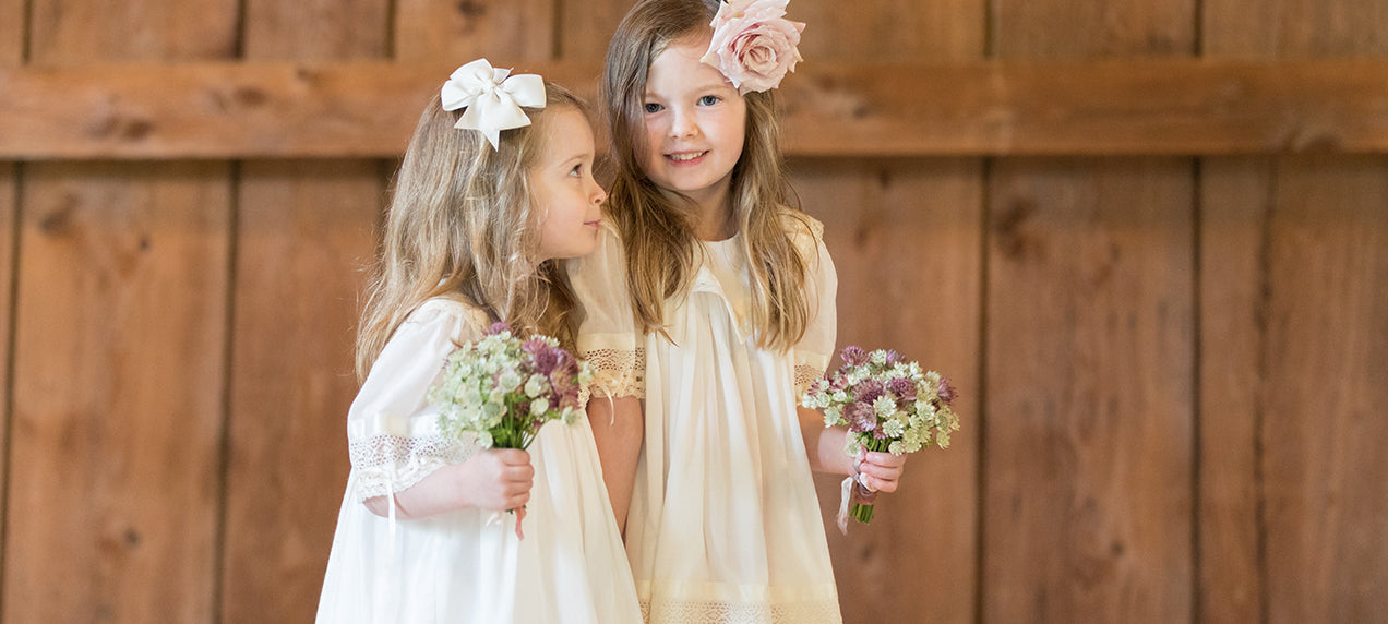 Heirloom flower girl dress ivory with lace inset and satin ribbons