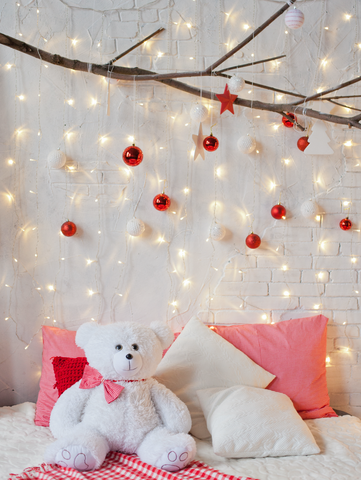 Christmas Decor With White Bear Sitting On A Bed