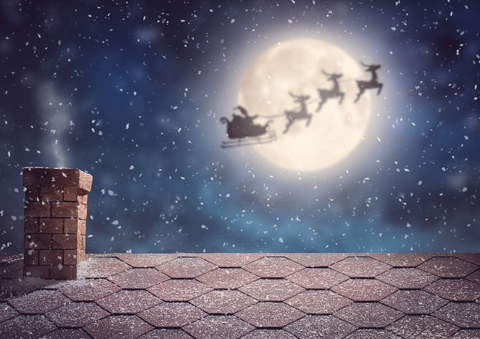 Santa Claus Flying In His Sleigh On Background Moon Sky