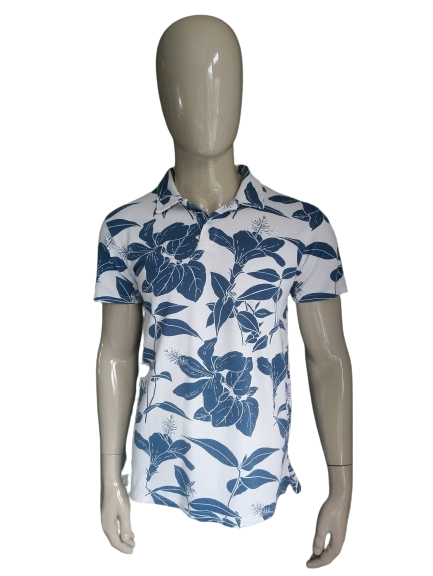 Pull & Bear polo. Blauw Wit Bloemmotief. Maat M