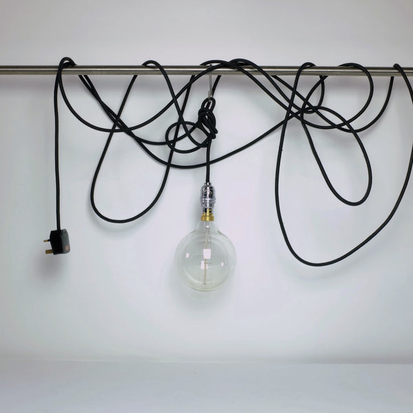 Long black cable hanging light