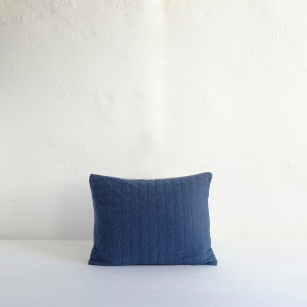 Blue quilted cushion