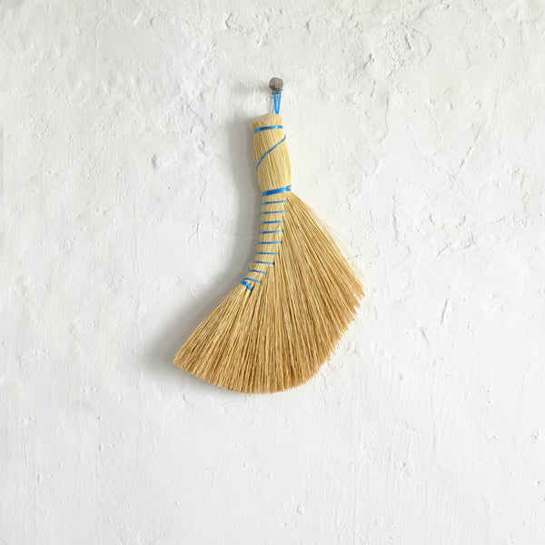 Curved hand broom with blue thread