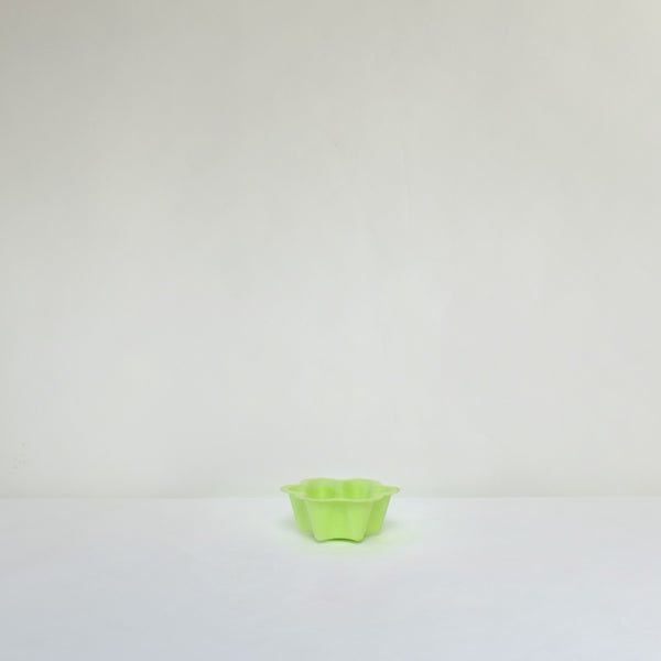 Green scalloped edged paper bowl