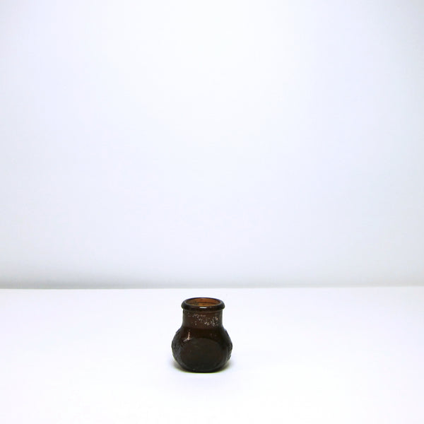 Small brown glass jar
