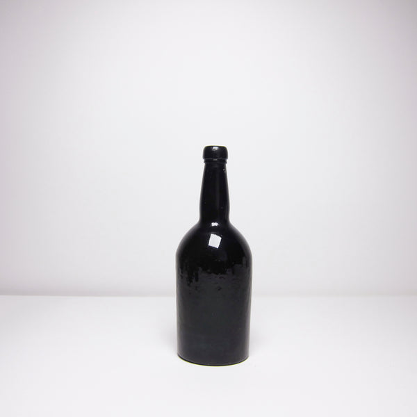 Vintage black glass bottle
