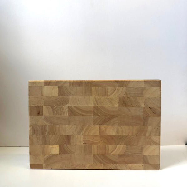 Thick wooden chopping board