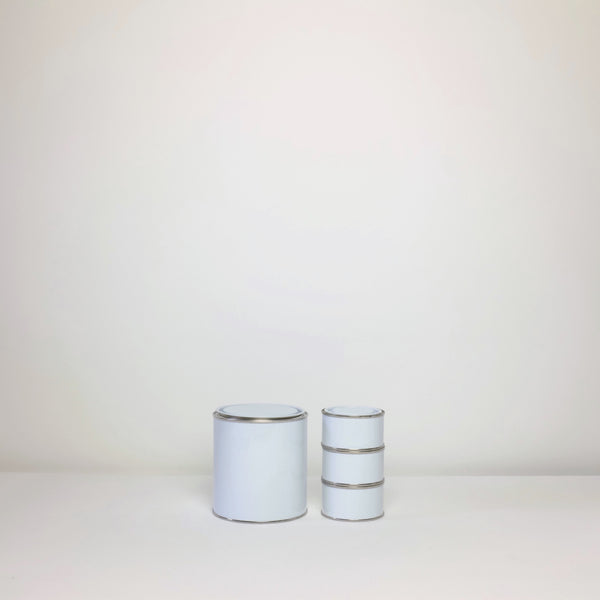 Plain white paint tins