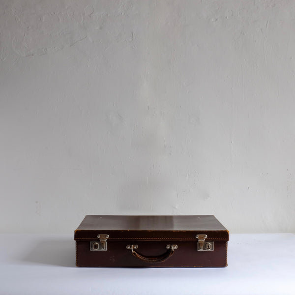 Thin brown leather suitcase