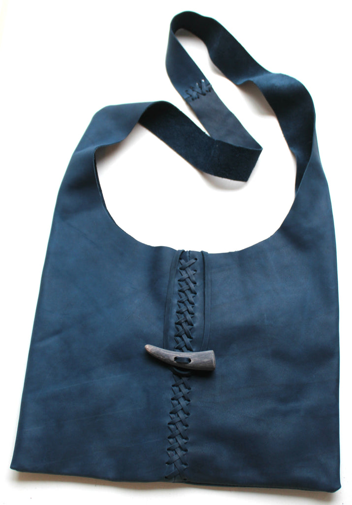 CRISS CROSS HANDBAG - in suede or leather
