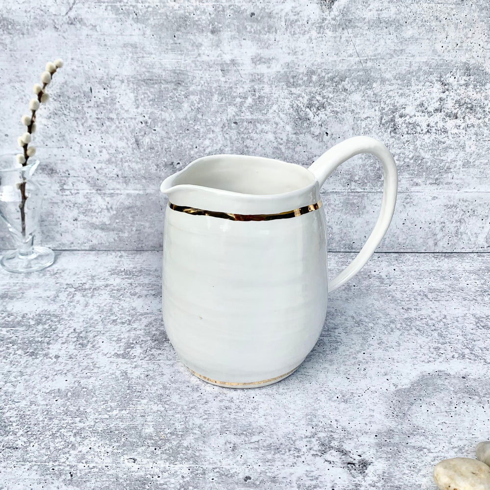 Elegant White and Gold Water Pitcher