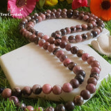 Rhodonite Crystal Japa mala: To achieve your Highest potential