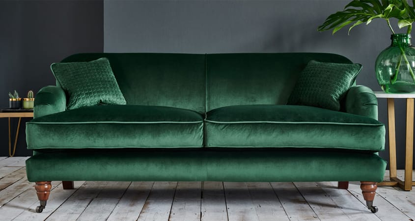 Emerald green sofa with gold tones